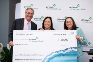 Jim Robo, Lisa Johnson, and Meredith Trim with Girl Scouts of Southeast Florida Donation